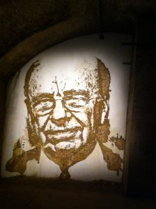 Vhils, title unknown, 2011, portrait carved out of the wall, in 'The Minotaur' at Old Vic Tunnels, Waterloo, London. Photo credit Kelise Franclemont.