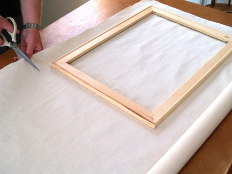 Stretching canvas, measuring to fit the frame. Image courtesy craftsy.com