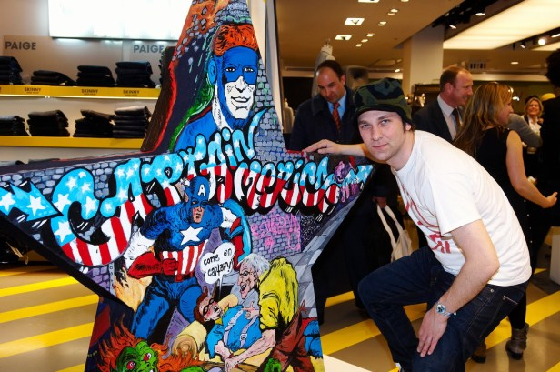 Artist James Jessop poses with his work in Selfridge's Art Stars. Image courtesy HookedBlog.co.uk