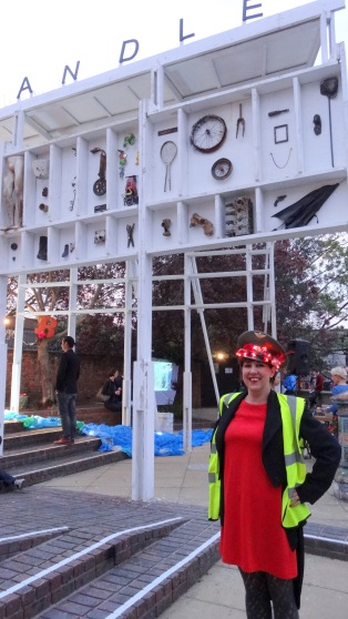 Eleanor Barrett, a co-director of The Brick Box, in front of 'The Cabinet of Curiosities', at Wandsworth Arts Festival Hub. Image courtesy Kelise Franclemont