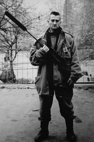 Adela Jusic, 'The Sniper', 2007, film/animation. Photograph of Jusic's father in uniform holding his sniper's rifle. Image courtesy the artist and www.alancristea.com