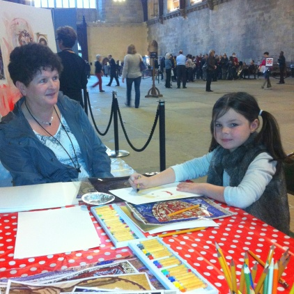 Asle (right) with a family member, in the Big Draw area in Westminster Hall, after the public tour of the Houses of Parliament. Photo credit Kelise Franclemont.