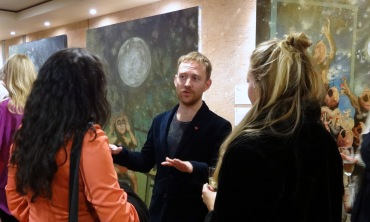 Artist Tom de Freston talking with visitors at 'Paintings after Shakespeare' at The Globe Theatre, London. Photo credit Kelise Franclemont.