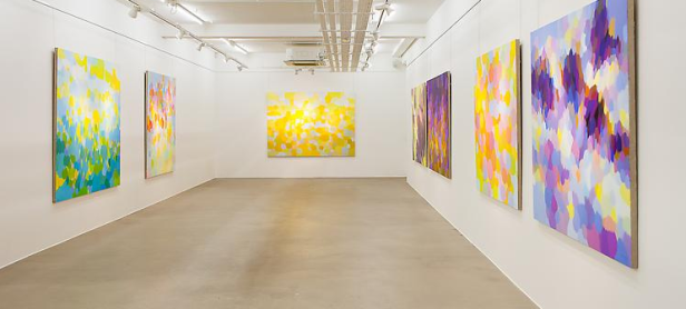 Installation view of 'Samia Halaby - New Paintings' at Ayyam Gallery, London. Image courtesy Ayyam Gallery.
