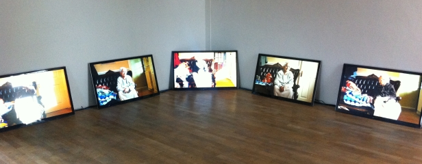 Hetain Patel, 'Mamai', 2012, installation of 5 videos 8:33, in 'At Home' at Pumphouse Gallery, London. Photo credit Kelise Franclemont.