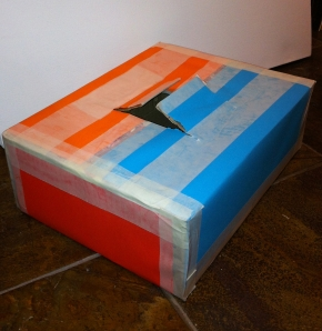 My touchy-feely box, made from an Amazon carton, some coloured paper and a bit of masking tape. Image courtesy Kelise Franclemont.