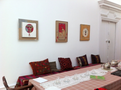WAMI (Yaseen Wami, Hashim Taeeh), untitled (round mask and face', 2013, cardboard and mixed media, with installation and tea room, in 'Welcome to Iraq' at South London Gallery, London. Photo credit Kelise Franclemont.