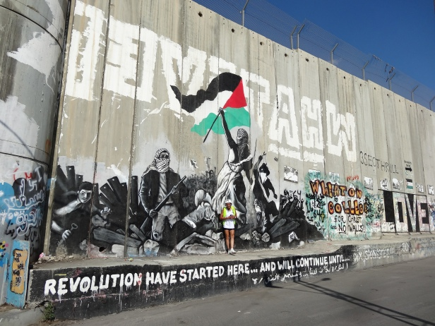 The Wall in Bethlehem, on the way to Jerusalem. 'The revolution has started here...and will continue...'