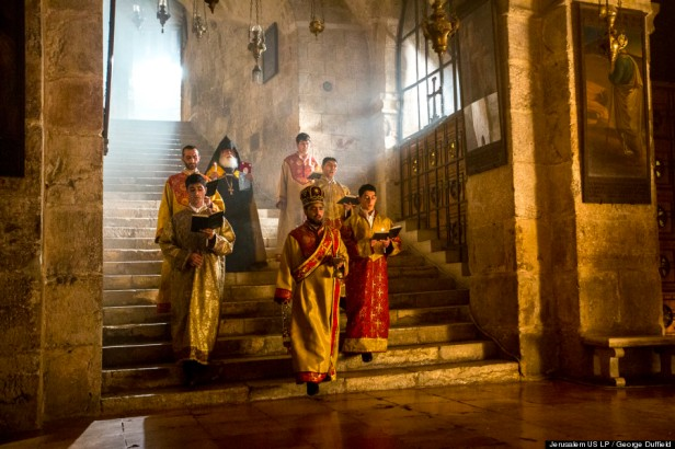 Armenian Apostolic priests descend the stairs to the Chapel of St Helena in the Church of the Holy Sepulchre. According to tradition, Queen Helena, mother to the Emperor Constantine, discovered remnants of the True Cross here in the 4th century C.E. (AD) during the construction of the original church, in 'Jerusalem 3-D', 2013, documentary film, 45 mins. Image courtesy National Geographic and The Huffington Post. Photo credit George Duffield.