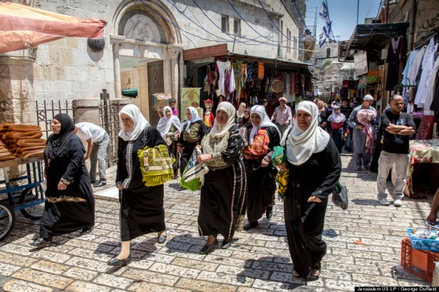 Muslim women in embroidered Palestinian dress on their way to mid-day prayer at Al-Aqsa Mosque, Haram al-Sharif, Jerusalem, in 'Jerusalem 3-D', 2013, documentary film, 45 mins. Image courtesy National Geographic and The Huffington Post. Photo credit George Duffield.