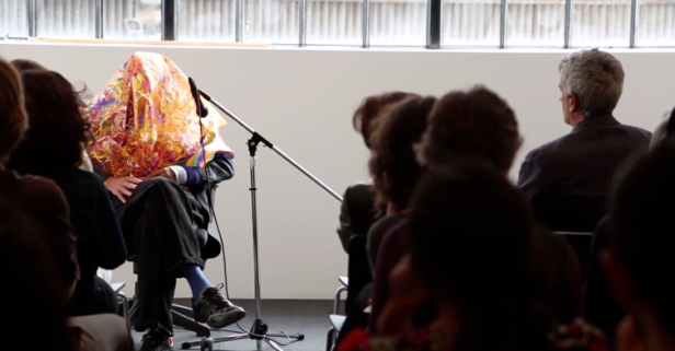 Screen shot from video recording of the artist talk in which Jimmie Durham dons a 'disguise' and discusses his practice, at Parasol Unit, 12 June 2014. Image courtesy Parasol Unit.