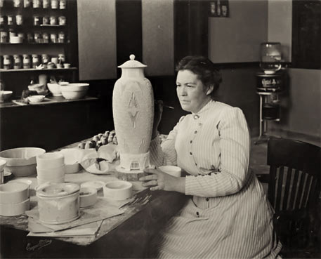 Adelaide Alsop Robineau (1865-1929), American potter, painter and ceramicist, in her studio with 'Scarab Vase (The Apotheosis of the Toiler)', 1910, porcelain, in Everson Museum of Art, Syracuse, NY. Image courtesy www.veniceclayartists.com