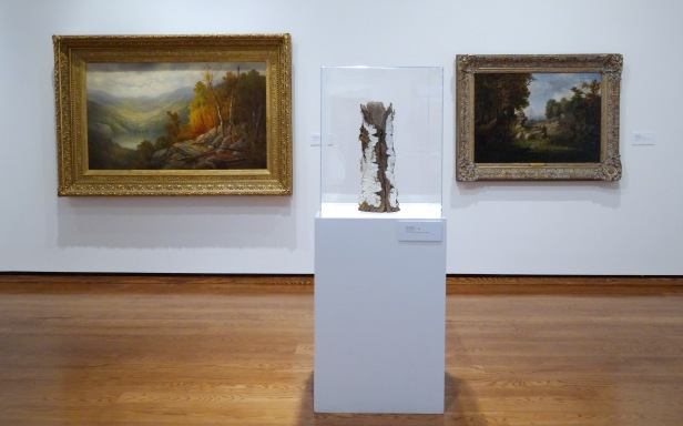 (l-r) William Ongley, 'Early Autumn, Adirondacks', 1880, oil on canvas; Eric Serritella, 'Birch Bark Vase', 2008, stoneware; and George Inness, 'A Nook Near Our Village', 1849, oil on canvas, at Everson Museum of Art, Syracuse, NY. Photo credit Kelise Franclemont.