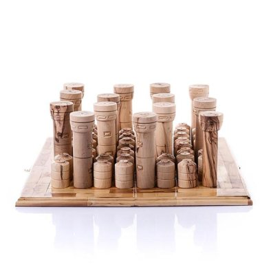 'Watchtowers and Watertanks game', olive wood, size variable. Designed by Mark Jan Van Tellingen, carved by Majed Abu Farha and Nader Rishmawee. Image courtesy the artist and Disarming Design.
