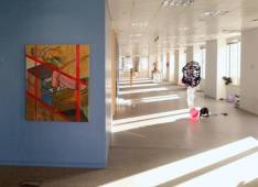Work by Josephy Lichy (left) with Installation view of 'Office Party' in 'Office Sessions III' at Anchorage House, East India docks, London. Photo credit Adam Zoltowski.