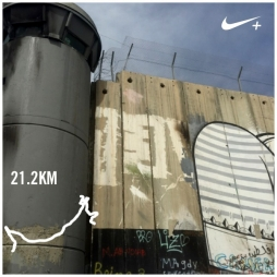 The Apartheid Wall and watchtower along the course of the Palestine Marathon 2015, Bethlehem, Palestine (Occupied Territories). Image courtesy Nike+ and Kelise Franclemont.