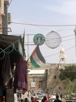 View of Star Bucks cafe, and the Church of the Nativity in the background, Palestine Marathon 2015, Bethlehem, Palestine (Occupied Territories). Photo credit Kelise Franclemont.