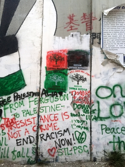 Detailed view of graffiti on the apartheid wall on the course, Palestine Marathon 2015, Bethlehem, Palestine (Occupied Territories). Photo credit Kelise Franclemont.