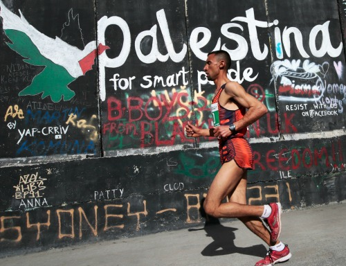 Nader al-Masri from Gaza in the Palestine Marathon with a time of 2:57, Bethlehem, Palestine (Occupied Territories), 27 March 2015. Photo courtesy EPA/JIM HOLLANDER.