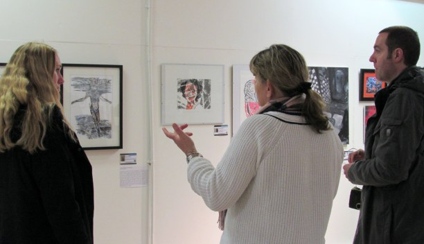 Karen Wroe (centre) with visitors at preview evening of 'Identity', at AWAH, Altrincham. Photo credit Rebecca Wild.