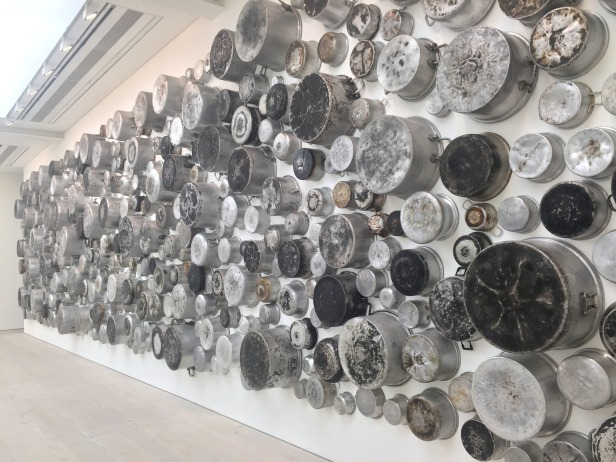 "Maha Malluh, 'Food for Thought ""Almuallaqat 4""', 2016, 478 burnt pots, in 'Champagne Life' at Saatchi Gallery, London. Photo credit Kelise Franclemont."