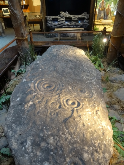'Art in Stone', a fine example of 'petroglyphs' (rock carvings) likely from the Mississippian tribes from AD900-AD1500, at Funk Heritage Center at Reinhardt University, Waleska, Georgia. Photo credit Kelise Franclemont.