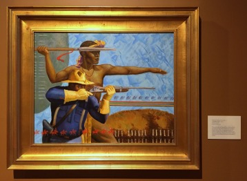 Ernest E Varner, 'A noble past', 2002, oil on canvas, at Booth Western Art Museum, Cartersville, GA. Photo credit Kelise Franclemont. The card reads: 'This painting was inspired by a Zulu warrior performance the artist observed in South Africa with a re-enactment unit of Buffalo Soldiers from Atlanta. It focuses on the proud heritage African-American soldiers inherited from skilled tribesman throughout Africa.'