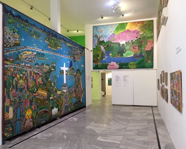 (left) Lia Mittarakis, 'Rio de Janeiro, I like you and your happy people', 1983-88, acrylic on canvas and wood, (right) Aparecida Azedo, 'My darling Amazon, green and yellow heart of Brazil', 1992-3, Acrylic on canvas and wood, Museu Internacional de Arte Naïf do Brasil, Rio de Janeiro. Photo: Kelise Franclemont.