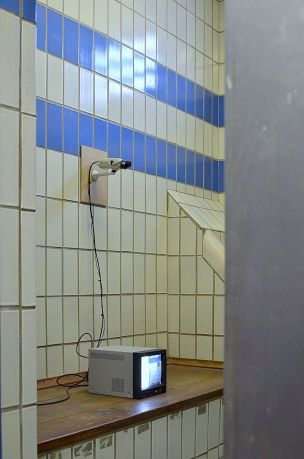 Paul Abbott, detail of 'Mirror (100 percent), 2016, privacy film, CRT monitor, CCTV camera, electrics, in 'The Room is the Resonator', at The Old Police Station, Deptford, London. Image courtesy the artist.