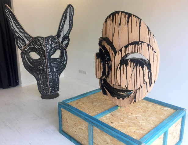 Adam Zoltowski, (l-r) 'Mask of Anubis' and 'Portrait of Monika', 2016, in 'Foreign Bodies', 242 Cambridge Heath Road, London. Photo credit Kelise Franclemont.